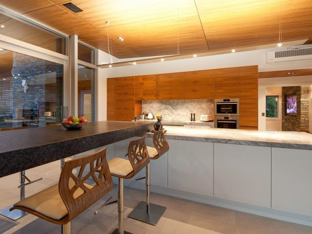 Modern kitchen in the glass house