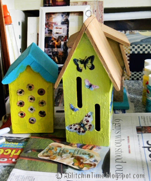 Bird houses being repainted and redecorated.