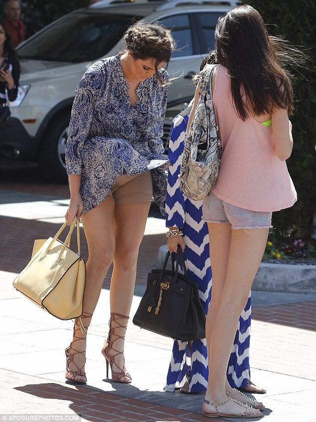 Khloe Kardashian 's Nude Spanx Exposed As Wind Blows Up Mini Dress