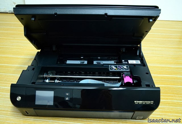 Flip open the printer and you have the slots to insert your ink cartridges