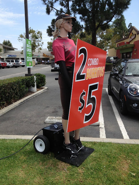 Robots to replace low paid sign waviers.