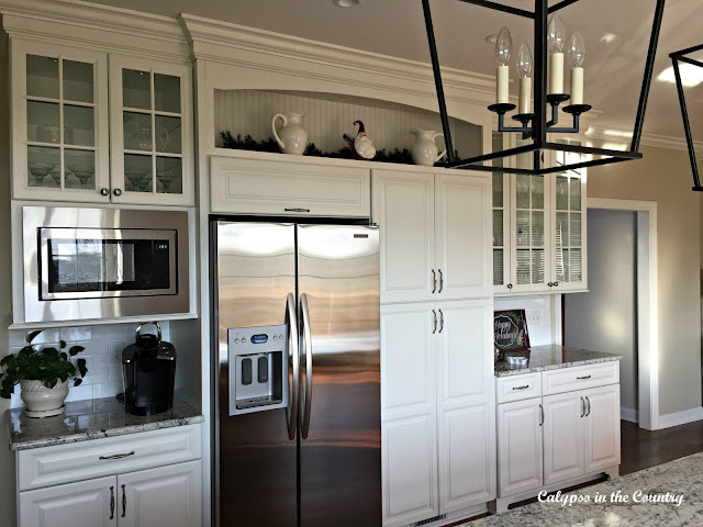 Refrigerator Wall with White Cabinets
