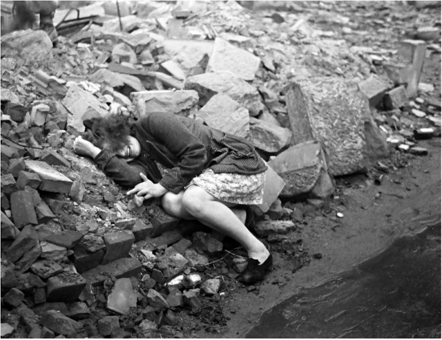 A woman crying the day Dessau was bombed by 520 allied aircraft, March 7, 1945