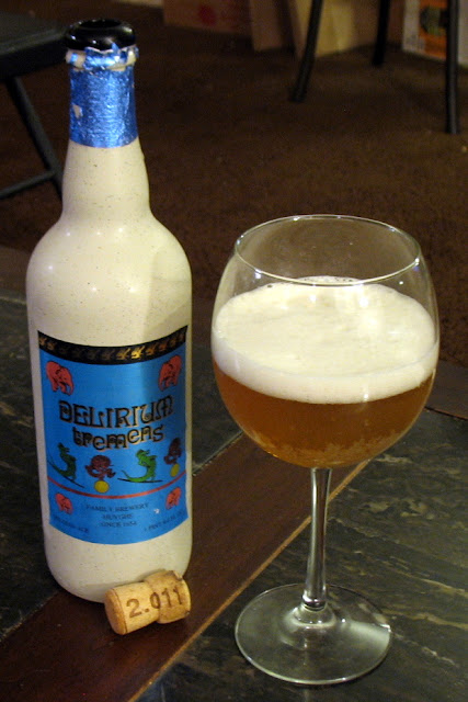 A bottle of Delirium Tremens with glass and cork.  Delicious!