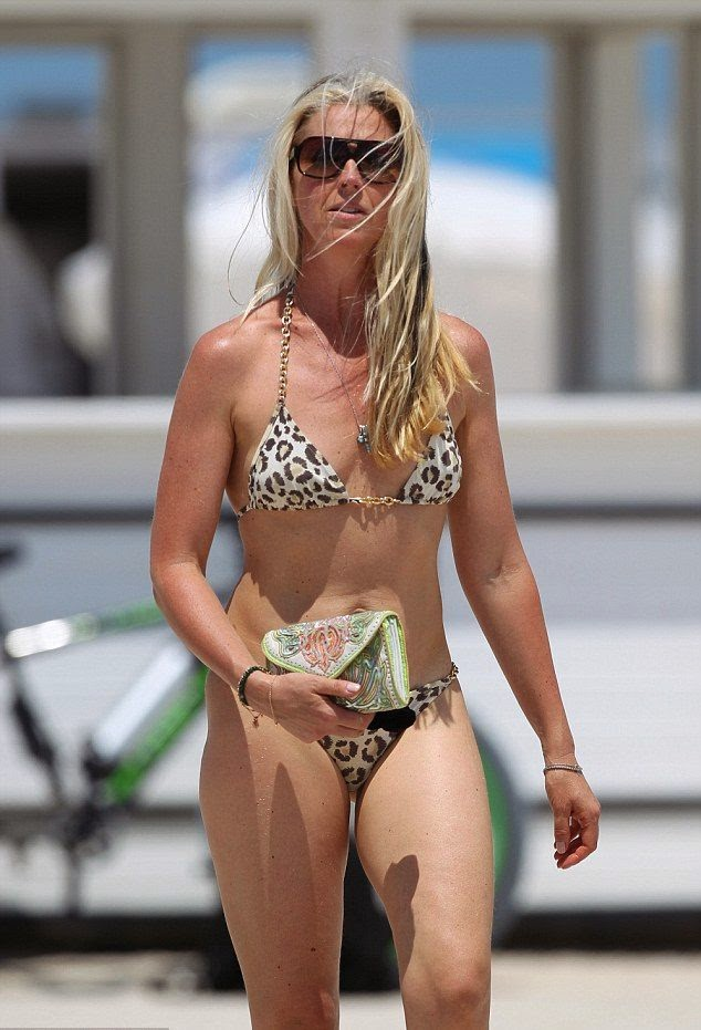 Tamara Beckwith showing off her secrets for staying so slim, including a diet filled while enjoying a spring and sunny vacation with a female friend on Monday, April 14, 2014 in Miami vacation.