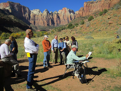 Roland Lee paints at the Footsteps of Thomas Moran Plein Air event In Zion National Park