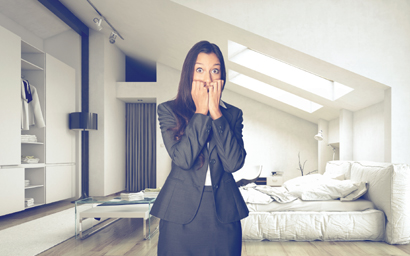 Frightened woman in fashionable, white apartment. copyright: PlusONE/Shutterstock.com