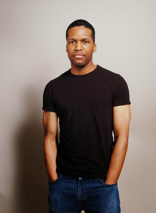 headshot of a black actor in washington dc wearing a dark t-shirt standing