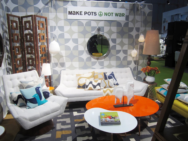 White and Orange kidney shaped coffee tables at Jonathan Adler's booth from the New York International Gift Fair