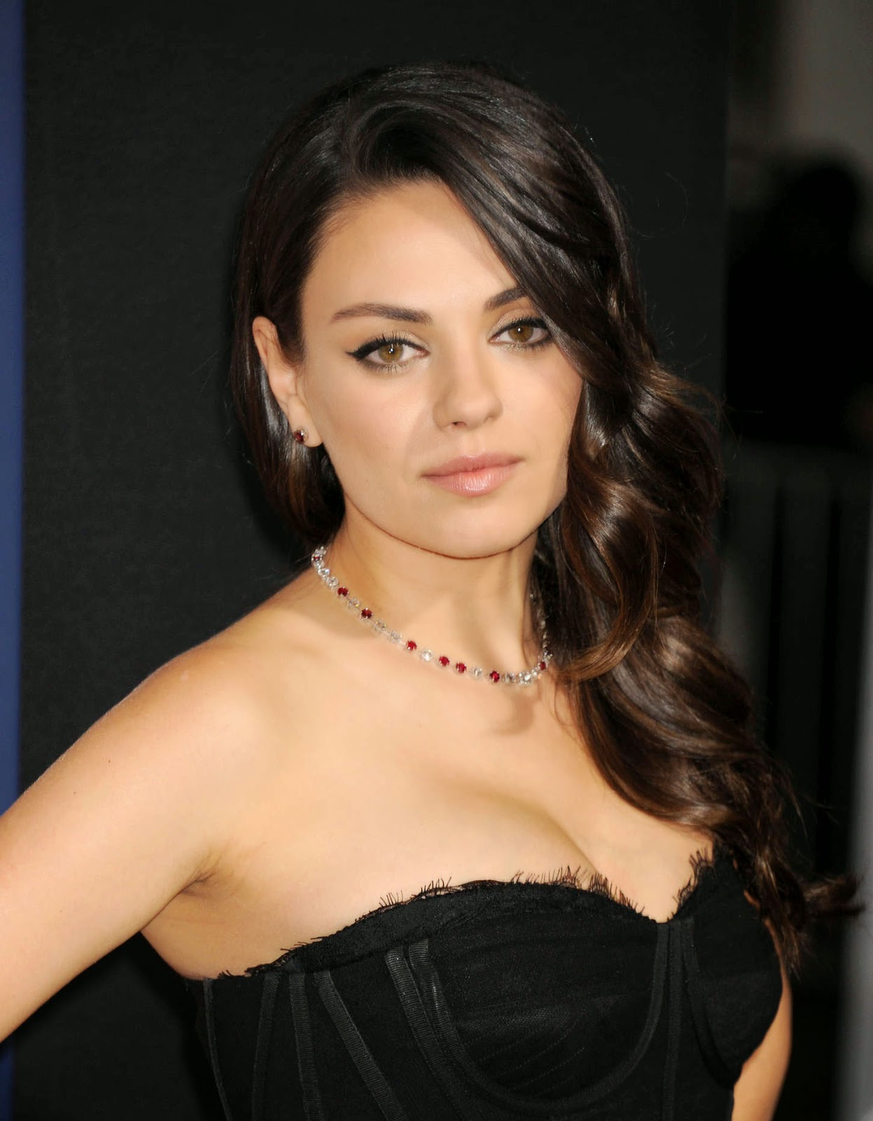 Mila Kunis flaunts a Dolce & Gabbana corset dress at the ... Mila Kunis