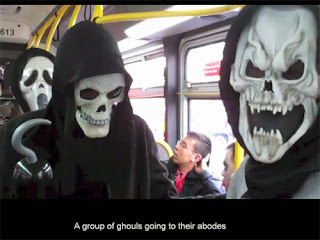 Bus riders in ghost costumes
