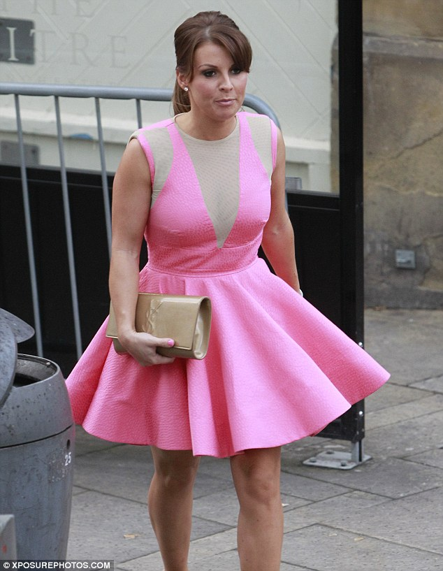 Candyfloss princess coleen rooney fails in the fashion stakes as she steps out in sickly pink Style me pink fashion show