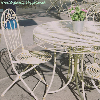 Wrought Iron table and chair at a little seaside cafe with parisienne decor. Llandudno, North Wales, seaside holiday.