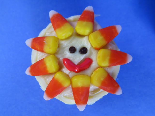 Lemon Sunshine Cupcakes - recipe for the best lemon cupcakes! Decorate with candy corn and icing for a fun summer treat!