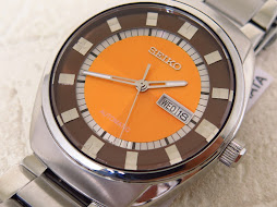 SEIKO RECRAFT SNKN75 ORANGE CHEKERBOARD PATTERN DIAL - AUTOMATIC 7S26