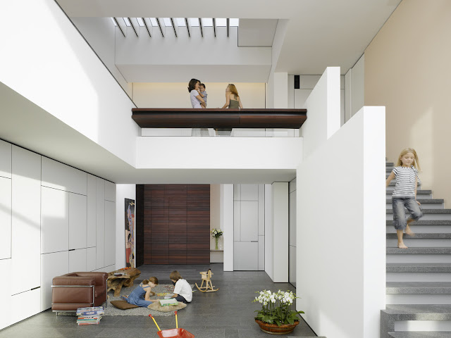Photo of interiors in an amazing home showing stairs and kids playing