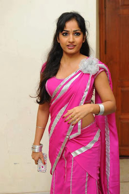 Typical Tamil girl looking homely in her pink saree and she is on the way to her boy friends birthday party.