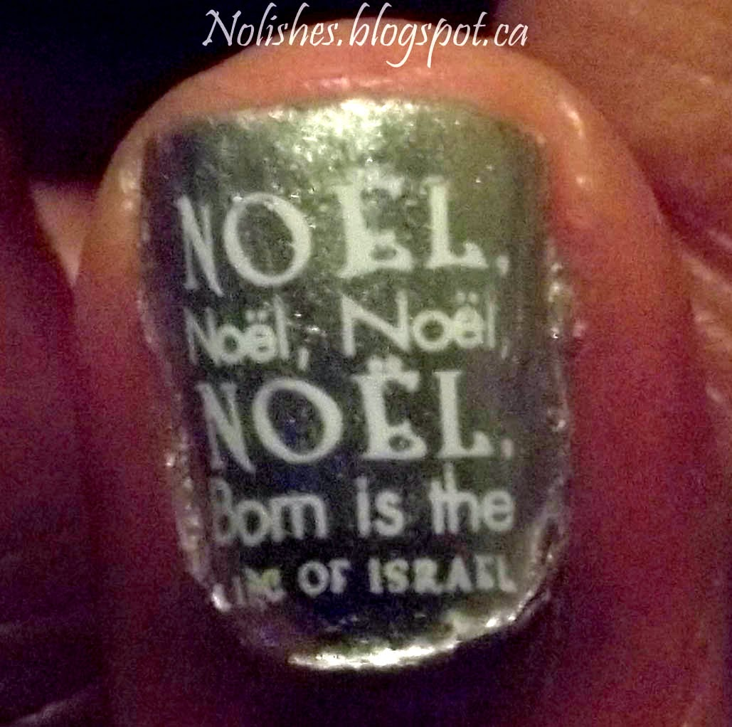 Nail stamping manicure featuring silver base with the lyrics to 'The First Noel' stamped over the base in white.