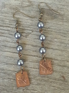 assemblage earrings with recycled pearls and antique school medals
