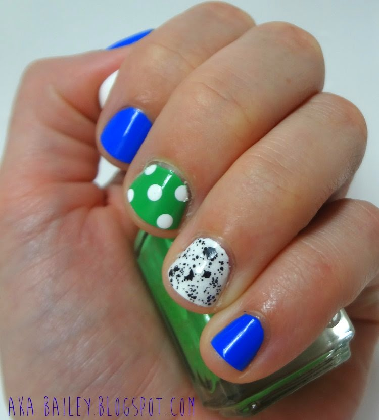 Blue nail polish and two accent nails, polka dots on Essie Mojito Madness