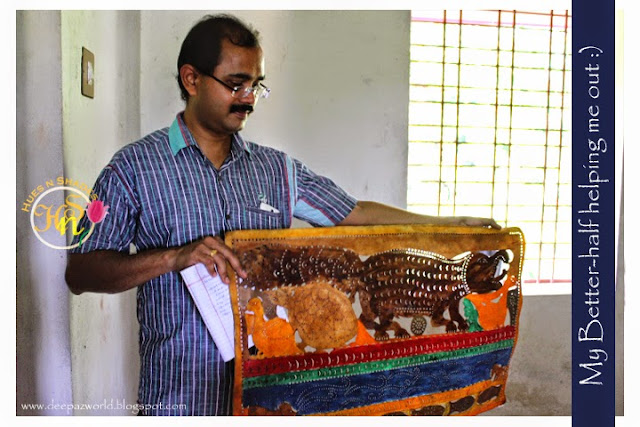 Hubby-holding-an-intricate-design-Tholpavakoothu-HuesnShades