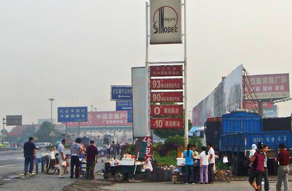 In China, people flock to petrol stations where street traders sell local food from their rickshaw trucks and bicycle trailers.