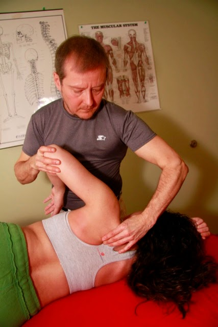 Deep tissue massage with remedial movement for the shoulder