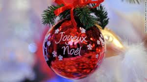 this is a christmas ornament known in french as les boules it says joyeux noel which is the french translation of merry christmas