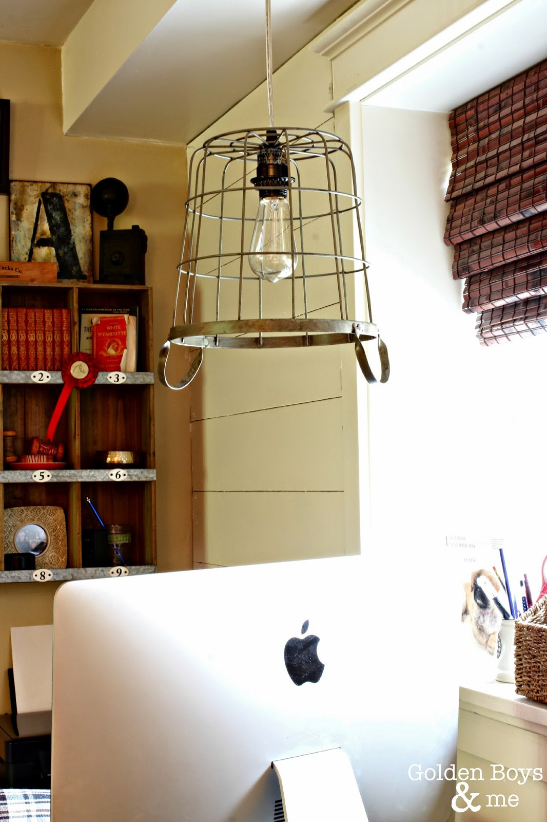 Metal basket used as a hanging pendant light with Edison bulb-www.goldenboysandme.com