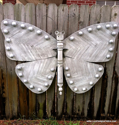 giant wooden recycled butterfly