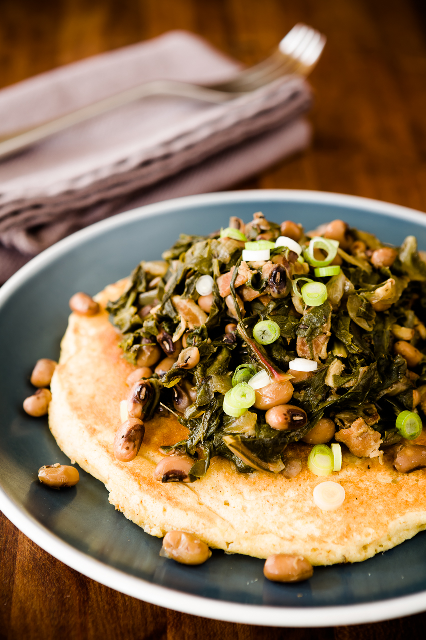 Start The New Year Right with Hoppin' John Served Over Cornmeal Pancakes