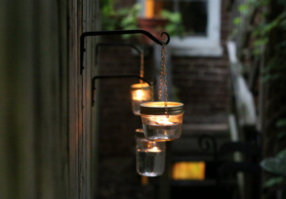 Over on ehow diy hanging mason jar lights 17 apart for Hanging lights made from mason jars