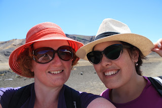 Selfie of me and Jenn, wearing hats and identical smiles.