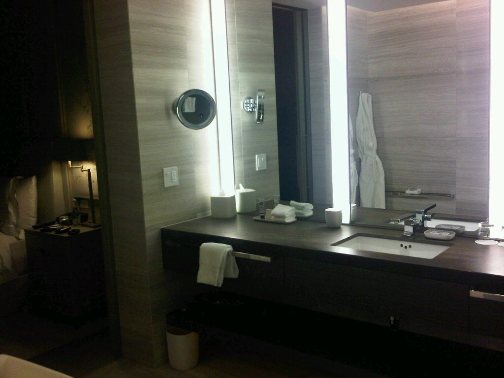 Really nice bathrooms - I Really Like The Look Of The Dark Brown Counter Top It Almost Looks Like Wood Paired With The Sleek Faucet And Those Nice Thick Towel Bars The Style Is