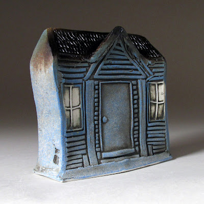 coin bank shaped like a house