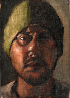 Oil painting of the head of a man wearing a green beanie.