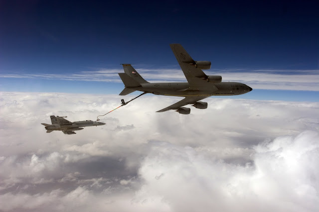 An F/A-18C Hornet receives fuel from an Air Force KC-135 Stratotanker