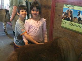 Children petting a miniature horse