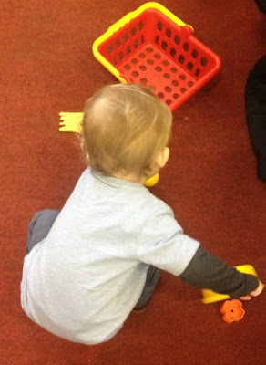 Toddler playing with toy saucepan and fries