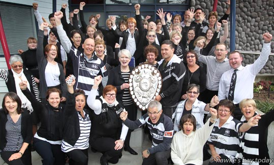 With shield: Geraldine Travers, principal - The Ranfurly Shield visited Hastings Girls' High School, Hastings, carried by Jesse MacDonald, hooker, Hawke's Bay Magpies rugby team photograph