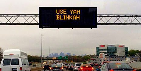 Electronic roadway sign: USE YAH BLINKAH
