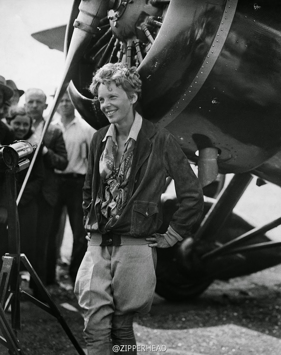 Amelia Earhart in front of an airplane in the 1930s.