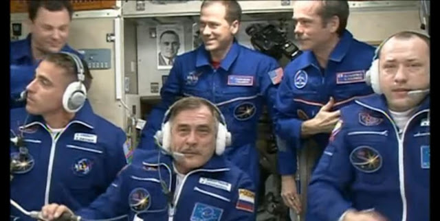 Shortly after the arrival of three new crewmates aboard the International Space Station, all six Expedition 35 crew members speak with family members and mission officials back on Earth. Photo credit: NASA TV