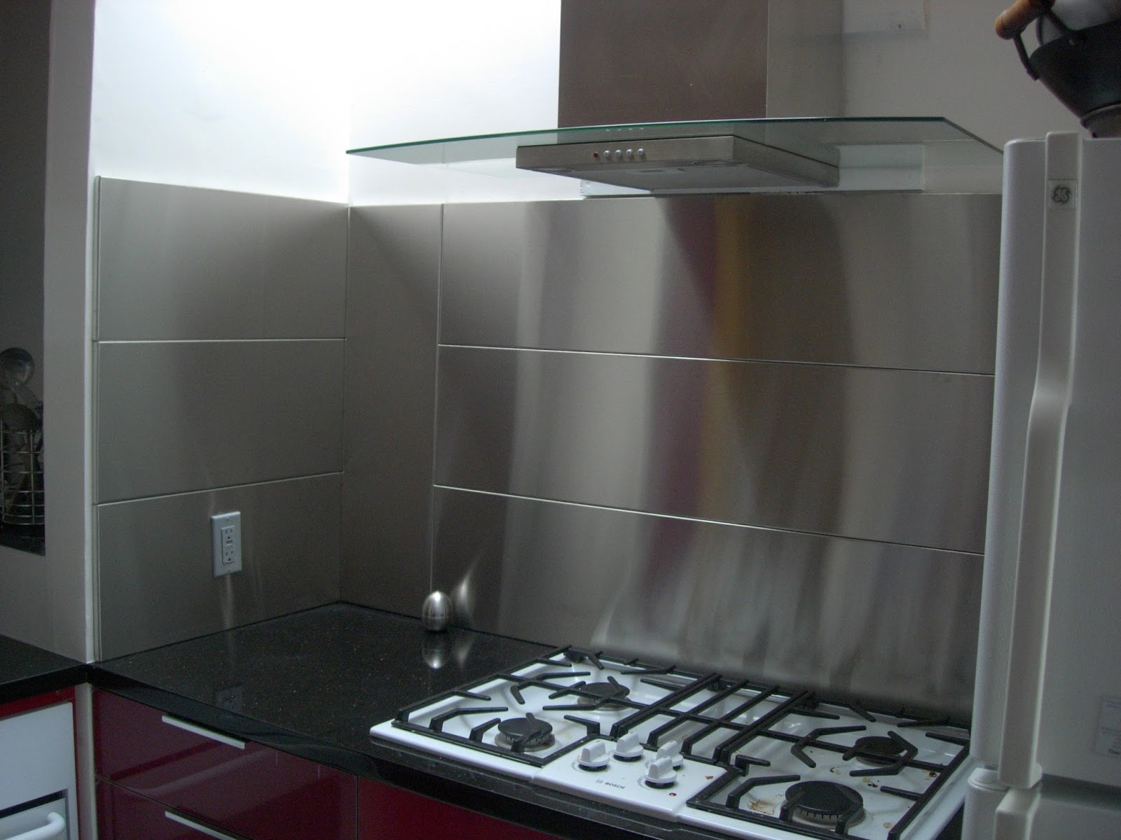 Stainless steel backsplash panel - Kitchen wall covering options ...