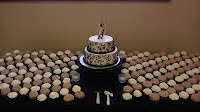 Wedding cake and cupcakes.