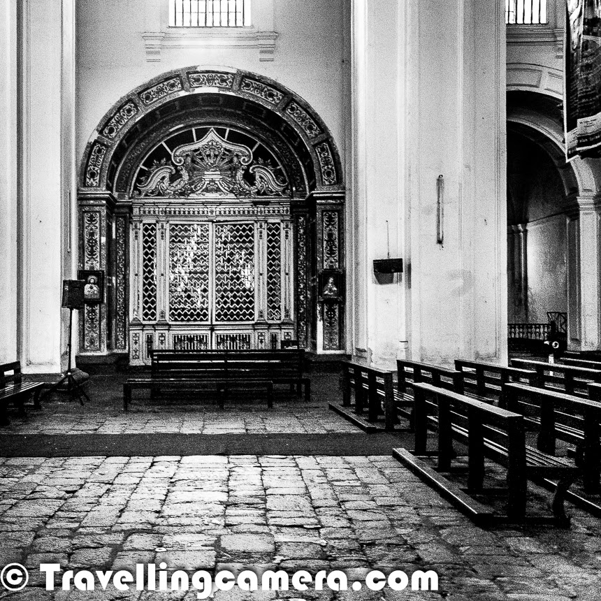 Different beaches come to our mind when we think about Goa, but Goa has many other interesting things to explore. And Old Goa has some of the beautiful architecture which takes you to a very different world. In this particular post, we are talking about two main churches situated in Old Goa - 'Se Cathedral' & 'Basilica of Bom Jesus'.The very first photograph of this Photo Journey shows entry to the Basilica of Bom Jesus which is located in old part of Goa. The Vasilica of Bom jesus is a UNESCO World Heritage Site. The Basilica holds the mortal remains of St. Francis Xavier. There aresome very interesting facts associated with this place and we recommend to find a guide to walk you through some of the interesting elements of The Basalica. It was third day of our Goa Trip, when we though of exploring Southern part of Goa. Old Goa is in southern region. From Panjim, one needs to drive through Goa Institute of Management to reach Se Catheral and Basilica of Bom Jesus. Both of these campuses are nearby and at walking distance. So we parked our car near Se Cathedral. Spent some time around the Cathedral and then walked to the Basilica.Se Cathedral is also known as The Se Catedral de Santa Catarina. This is the cathedral of the Latin Rite Roman Catholic Archdiocese of Goa. Supposedly it's considered as the largest church in India, which is dedicated to Catherine of Alexandria. Se Cathedral is one of the oldest and most celebrated religious buildings in Goa and is one of the largest churches in Asia as well.Above photograph shows the view of Cathedral from Basilica of Bom Jesus. Both of these are located across the road in Old Goa. Above photograph shows interiors of the Basilica of Bom Jesus. This church is located in Old Goa, which was the capital of Goa in the early days of Portuguese rule. 'Bom Jesus' name is used for the infant Jesus. The church is India's first minor basilica which is considered to be one of the best examples of baroque architecture in India.Another v