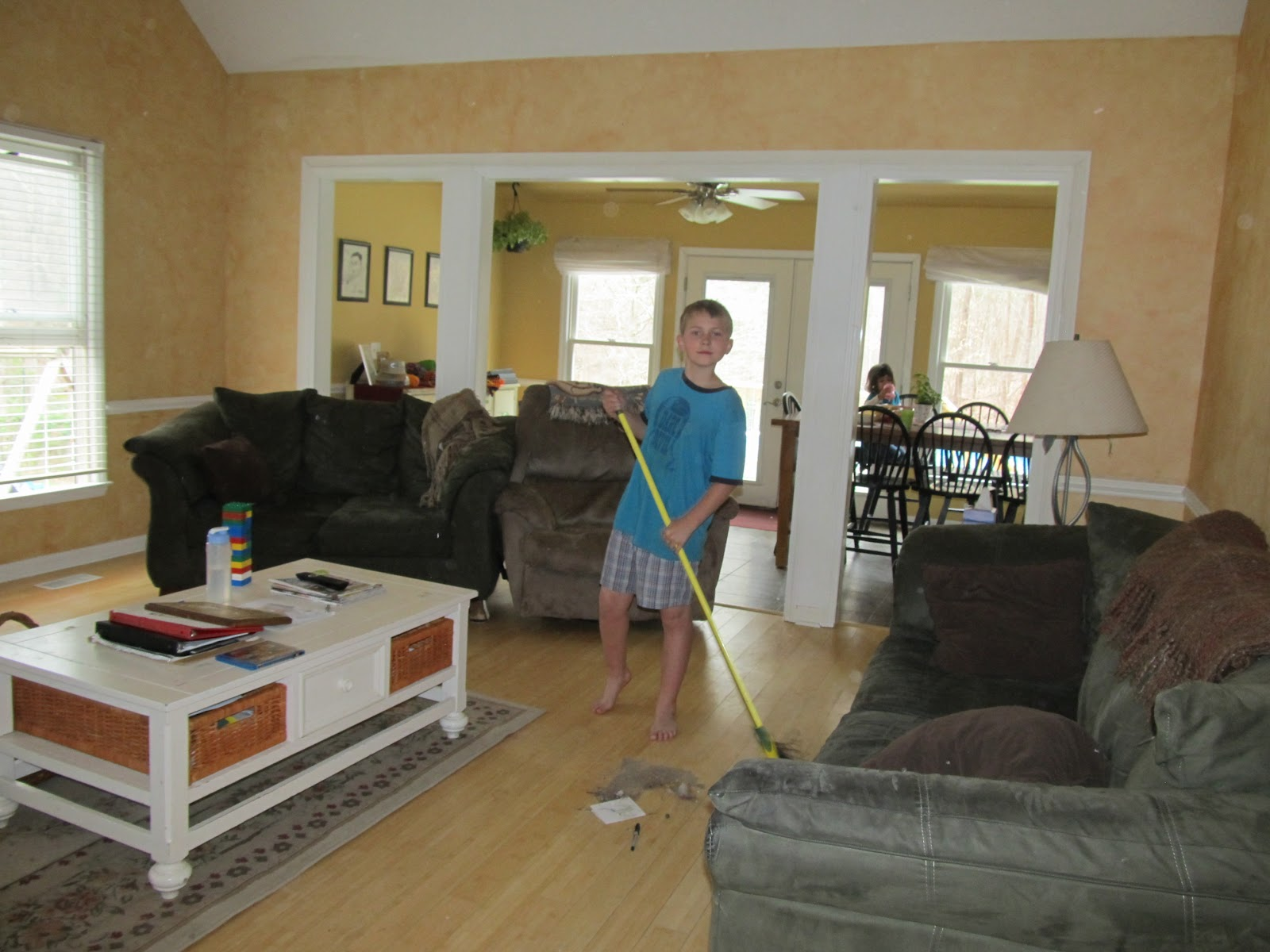 alex helping to sweep the living room deal was the title=