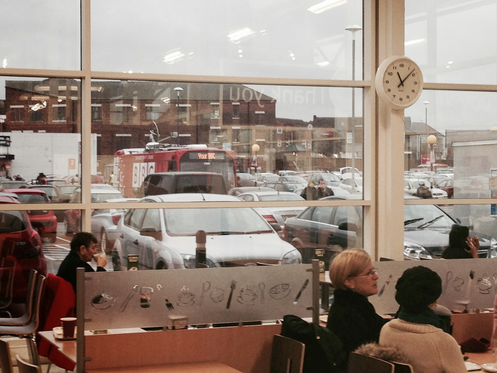 BBC Bus viewed from inside Tesco, Longton