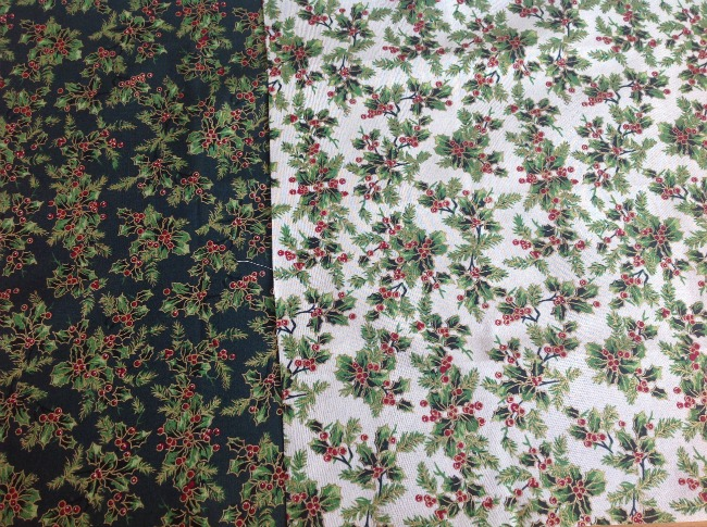 A dark green fabric with holly leaves and a white fabric with holly leaves