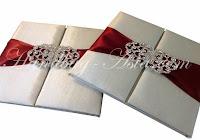 http://handbag-asia.com/IVORY-SILK-FOLIO-EMBELLISHED.htm